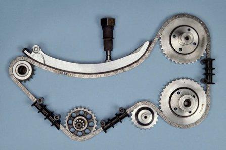 Steuerung mit Kettenspanner, Mercedes-Benz Motorteil des M 102 E 2.3-16; 16-Ventil-Einspritzmotor, 1984.